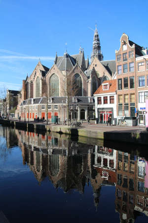 The Oude Kerk is located in the centre of  Amsterdams red light district and is the oldest building (over 800 years old) in the city. Editorial