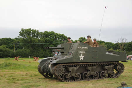 glorify: Waterlooville, UK - 28 May, 2017: The Solent Overlord Military Collectors Club staging a re-enactment of a second world war battle. The aim is not to glorify war, but to educate the watching public of a by gone era of World history.