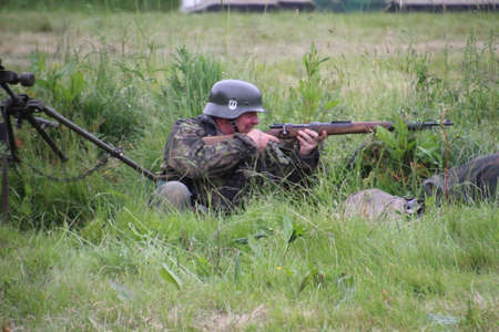 Waterlooville, UK - 28 May, 2017: The Solent Overlord Military Collectors Club staging a re-enactment of a second world war battle. The aim is not to glorify war, but to educate the watching public of a by gone era of World history.