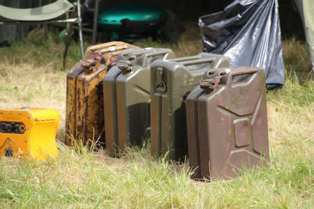 Jerry cans on display at a military vehicle show.