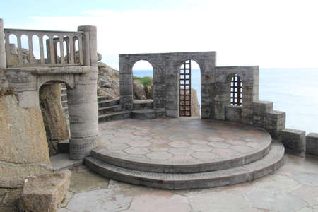 Porthcurno, UK - 4 November, 2017: The Minack open air theatre built into the cliff side in Porthcurno, Cornwall. This unique theatre has been staging performances since the 1920s and operates come rain or shine.