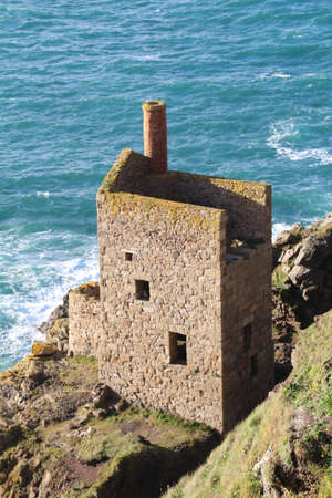 The remnants of the Crown Engine House, a tin mine in Botallack, Cornwall. Фото со стока
