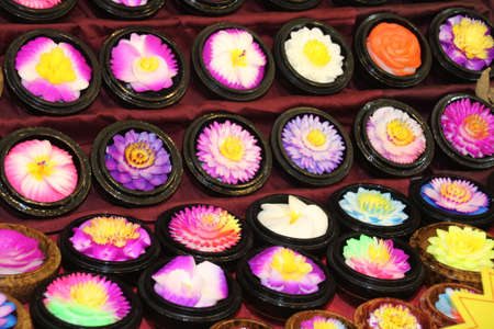 Soap carved into the shape of flowers on display in Hua Hin night market, Thailand. Banco de Imagens