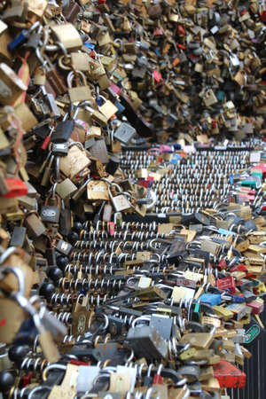 Padlocks attached to railings in Pecs, Hungary. It has become a tradittion to leave a padlock on completion of studies at the local university. They are also left to symbolise commitment to a partner.