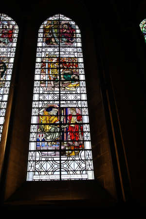 Stained glass window in Salisbury cathedral. One of many depicting images of saints, religious icons and the like. Foto de archivo - 95214030