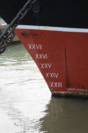 Ships loading lines. These are painted on the hull of the vessel to measure how low the vessel sits in the water.