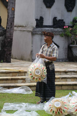 Bali, Indonesia - 31 May, 2018: Preparing for one of the many religious celebrations which take place on the Indonesian island of Bali. Each place of worship holds some sort of parade and due to the sheer number of churches, they seem to happen every day. Editorial