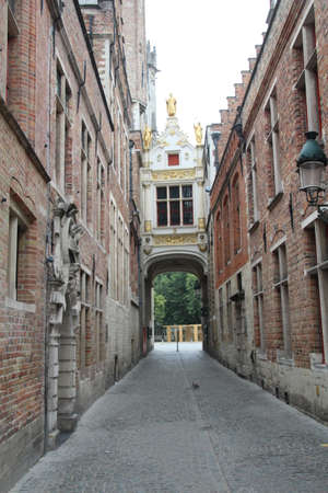 Covered bridge over the passageway connecting the fish market area to Burg Square in Bruges, Belgium. Stock fotó