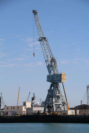 One of the many cranes in Portsmouth dockyard used to service the Royal Navy fleet. Stock Photo