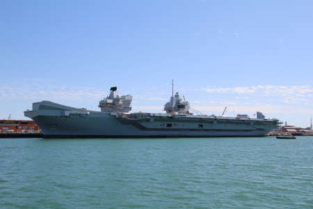 Portsmouth, UK - 5 August, 2018: The aircraft carrier Queen Elizabeth at anchor in its home port. This is the largest warship in the Royal Navy fleet.