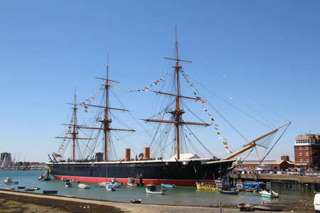 HMS Warrior moored in Portsmouth, England. HMS Warrior with her sister ship HMS Black Prince were the worlds first iron-clad warships.