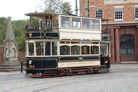 Newcastle, UK - 23 September, 2018: Old restored tram used to transport tourists around different areas of an open air museum.