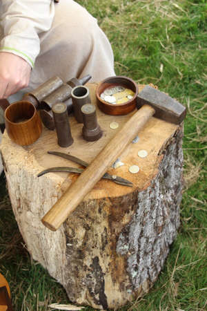 Tools for demonstrating how to make hammered coinage. Stock Photo