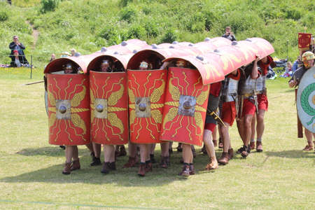 Old Sarum - May 27, 2019: Roman soldiers. Part of the re-enactment group Clash of the Romans, they tour the country demonstrating how Roman legions lived and fought during the occupation of Britain