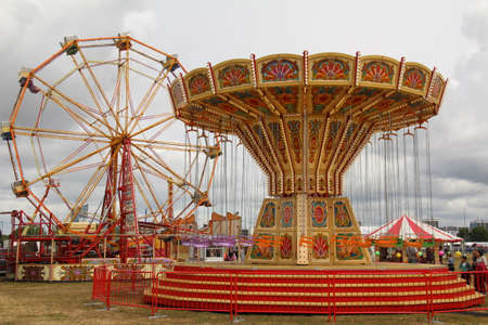 Southsea, UK - June 9, 2019: Chair o plane or swing carousel, part of a travelling fair set up on Southsea common as part of the recent D-Day celebrations. Editorial