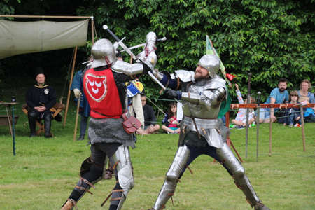 Battle, UK - 14 July, 2019: Knights tournament. Held throughout the Summer at several locations. Four knights re-enactors compete against each other in a series of trials using swords, longbow, mace etc, to establish who is the champion. Sajtókép