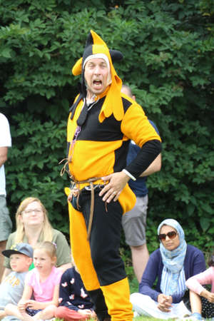 Battle, UK - 14 July, 2019: Medieval fool entertaining the crowd at the Knights Tournament.