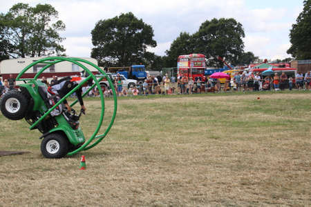 Southampton, UK - 28 July, 2019: Stunt driver demonstrating how to forward roll an adapted buggy with a roll cage at Netley Steam and Craft Show. Editorial