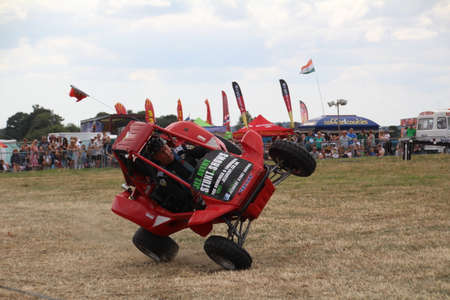 Southampton, UK - 28 July, 2019: Stunt driver demonstrating how to drive a buggy on 2 wheels at Netley Steam and Craft Show.