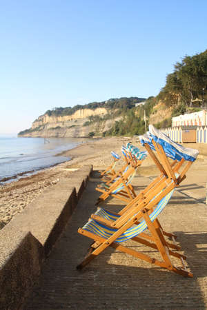 Deckchairs on the promenade overlooking Shanklin beach on the Isle of Wight.