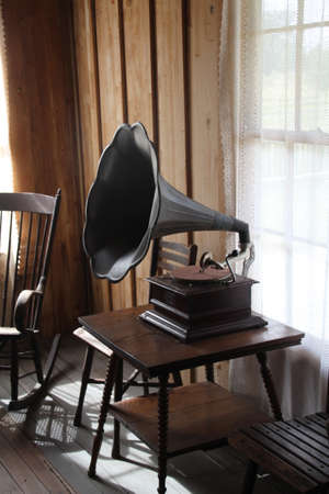 Old fashioned wind up gramophone. These played flat records as opposed to the phonograph which played wax cylinders.