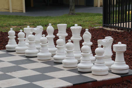 Giant chess set in a public park. Banco de Imagens