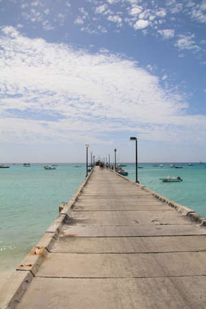 Boat jetty leading from a beach in southern Barbados.