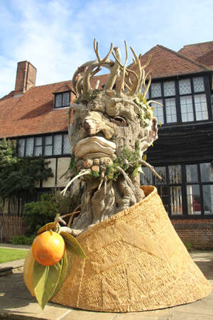 Woking, UK - 21 March, 2020: One of a series of four sculptures representing the four seasons. Constructed of fibreglass in the shape of a figure made from flora (fruit, wood, flowers), this sculpture represents Winter.