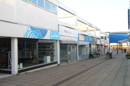 Waterlooville, UK - 6 November, 2020: Empty shops in a recession hit precinct, where only charity shops thrive because of favourable rents. This is common place in towns throughout the UK.