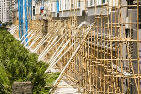 Construction site in Hong Kong with bamboo scaffolding Stock Photo