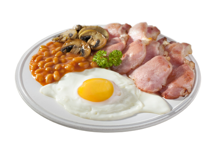 English breakfast of bacon, fried egg, mushrooms, baked beans on a plate, isolated on white and with clipping path provided.