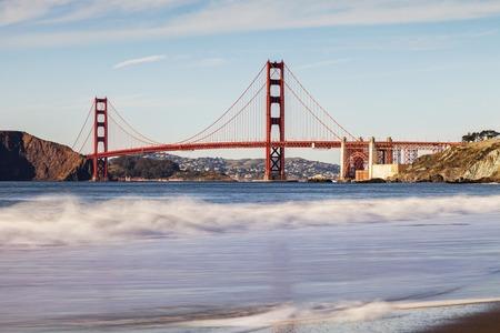 Golden Gate Bridge Evening and Waves Stock Photo