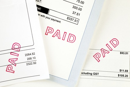 Three Invoices with Paid Stamp