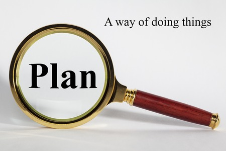 Plan Concept with Words and Magnifying Glass Standard-Bild