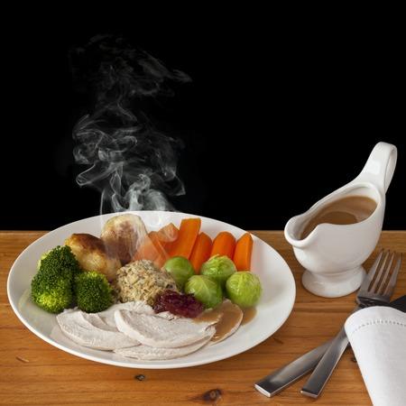 Roast Chicken Dinner with Steam Stock Photo