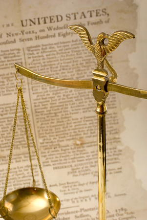 Scales of justice and Bill of Rights. Concepts of justice, law, history. Focus is on eagle.