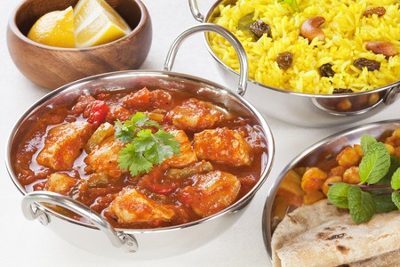 Indian Food Chicken Jalfrezi Curry and Yellow Rice Pillau Stock Photo
