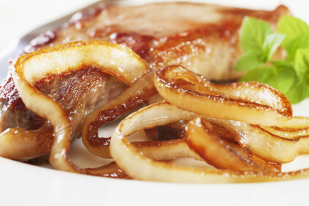 Caramelised Onions and Steak Stockfoto
