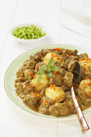 Beef Rendang on a Light Background Stock Photo