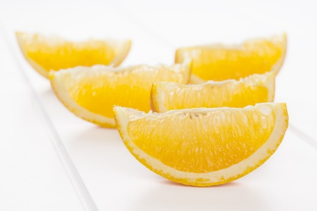 Orange Wedges on White Background Stok Fotoğraf