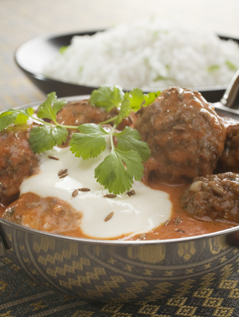 Spicy Indian Meatball or Kofta Curry with Basmati Rice Stock Photo
