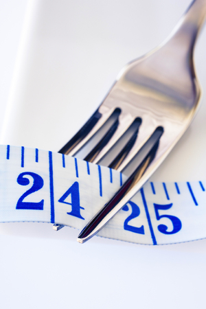 Fork and Tape Measure Showing 24 Inches