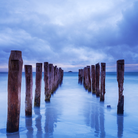 Gathering Storm Clouds Over Old Jetty Stock Photo