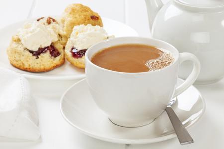 Tea with Milk and Fresh Scones Фото со стока