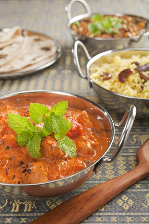 Indian curry chicken tikka masala with pilau rice Stock Photo