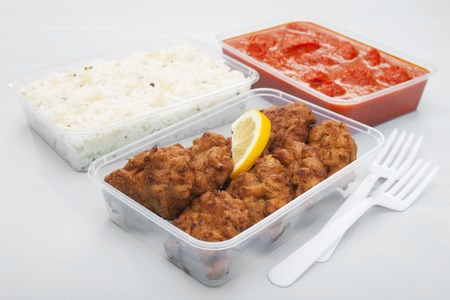 Indian takeaway food selection of onion bhaji chicken tikka masala