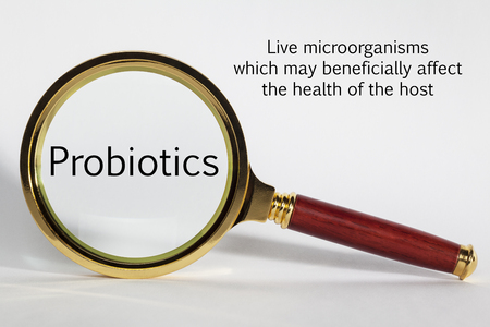 Probiotics Concept and Magnifying Glass