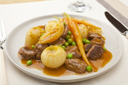 A French dish, navarin of lamb is a lamb stew with root vegetables, often served at Easter. It contains turnips, carrots, potatoes, onions and peas, in a thick glossy sauce.