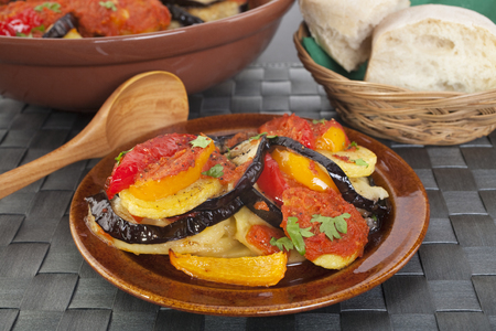 This dish is very popular in the Spanish island of Majorca, its a vegetarian casserole of fried potatoes, aubergines and pimentoes, baked in the oven with tomato sauce. Stok Fotoğraf