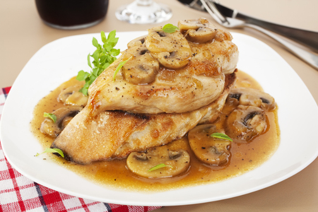 Chicken Marsala  - popular Italian American dish, Marsala Chicken, served over toasted baguette. Chicken breast in a rich, sweet sauce with marsala, chicken stock and mushrooms. Banco de Imagens